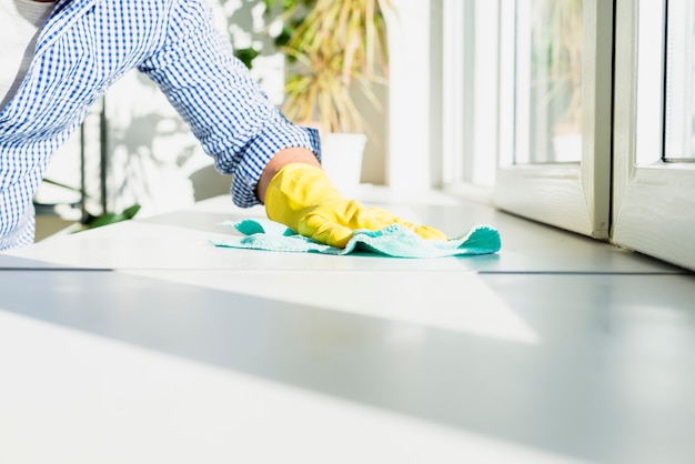 Man cleaning his home Free Photo