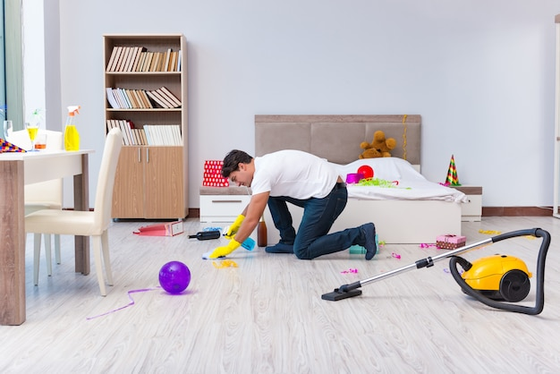 Man cleaning the house after christmas party Premium Photo