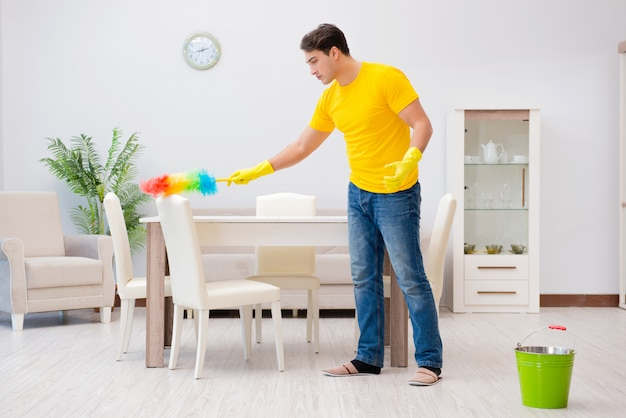 Man cleaning the house helping his wife Premium Photo