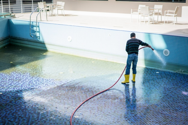 man cleaning pool 21730 11757