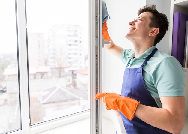Man cleaning windows Free Photo