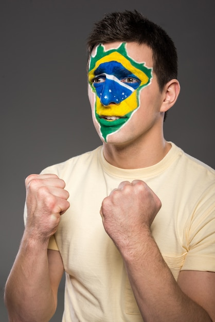 Man clenched his fists and rooted for brazil. Premium Photo