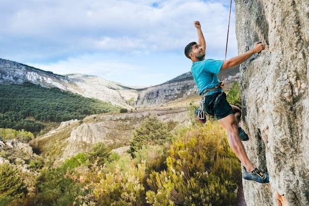 Man climbing rock in nature Free Photo