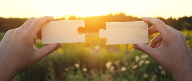 A man collects collects wooden puzzles at sunset. Premium Photo