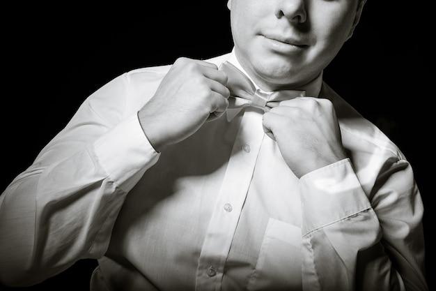 Man corrects a necktie Premium Photo