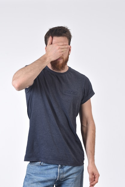 Man cover his eyes with his hand Premium Photo