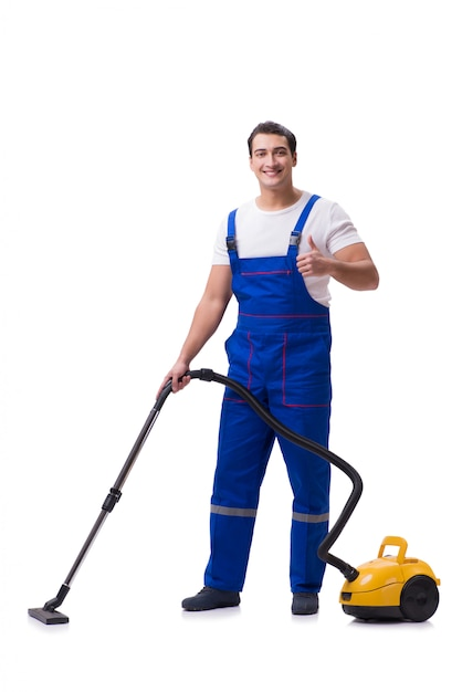 Man in coveralls doing vacuum cleaning on white Premium Photo