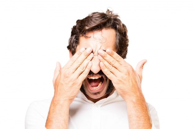 Man covering his eyes with hands Free Photo