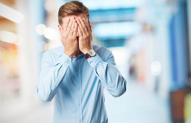 Man covering his eyes Free Photo