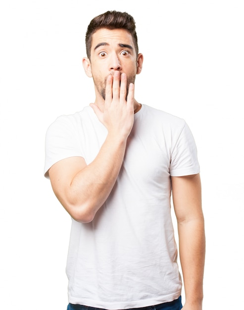 Man covering his mouth with one hand Free Photo