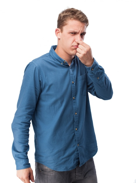 Man covering his nose Free Photo