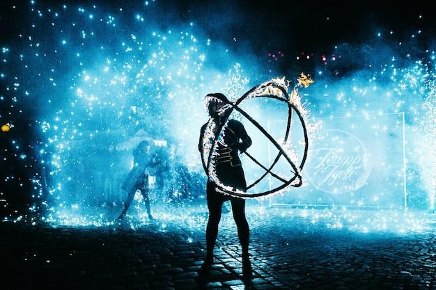 Man dances with fireball Premium Photo