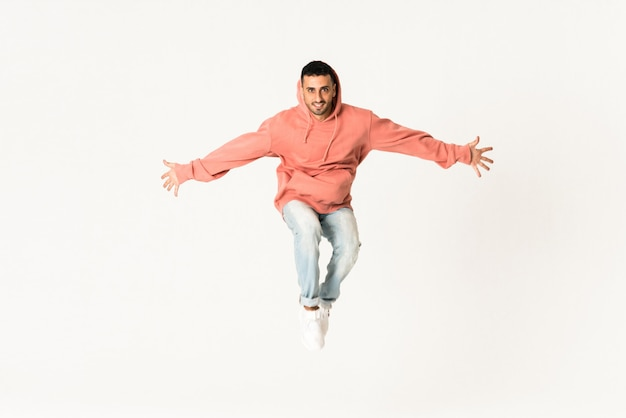 Man dancing street dance style over isolated white wall Premium Photo
