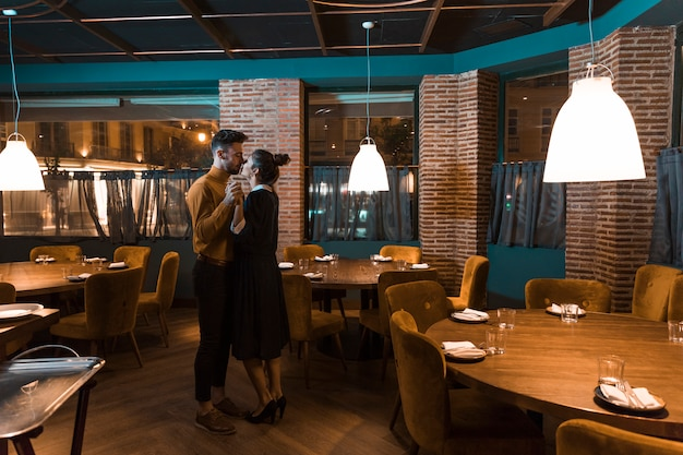 Man dancing with woman in restaurant Free Photo