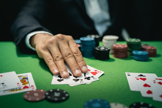 Man dealer or croupier shuffles poker cards in a casino Premium Photo