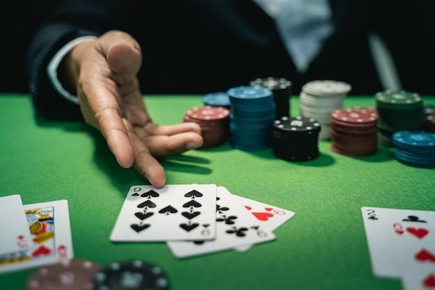 Man dealer or croupier shuffles poker cards in a casino Premium Photo