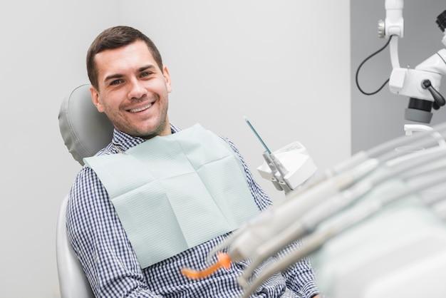 Man at dentist Free Photo