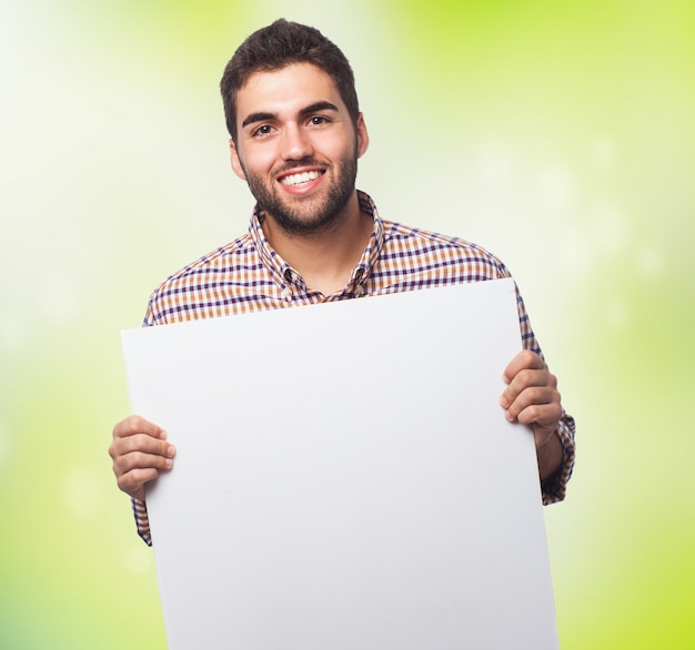 Man displaying empty sheet of paper Free Photo