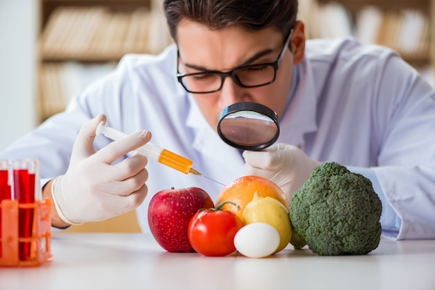 Man doctor checking the fruits and vegetables Premium Photo