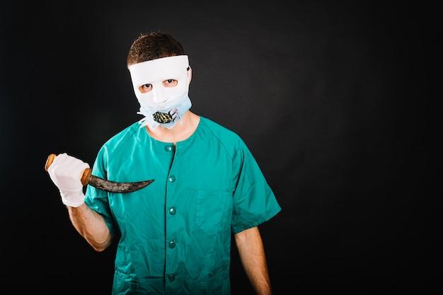 Man in doctor halloween costume Free Photo