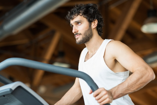 Man Doing Cardio Workout In A Fitness Club Premium Photo