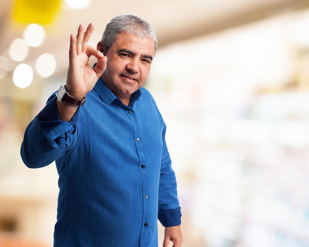 Man doing ok gesture Free Photo