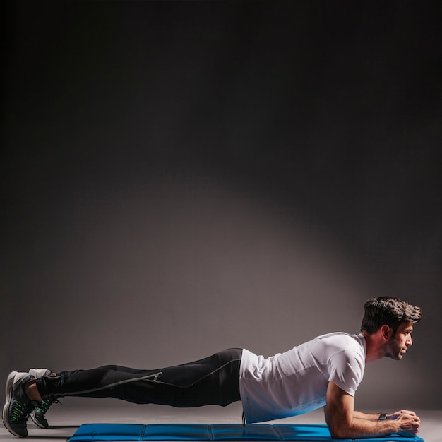 Download This Free Photo Man Doing Plank Exercise