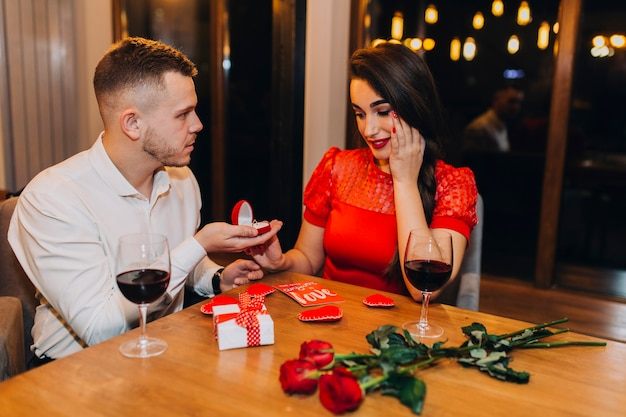 Man doing proposal in restaurant Free Photo