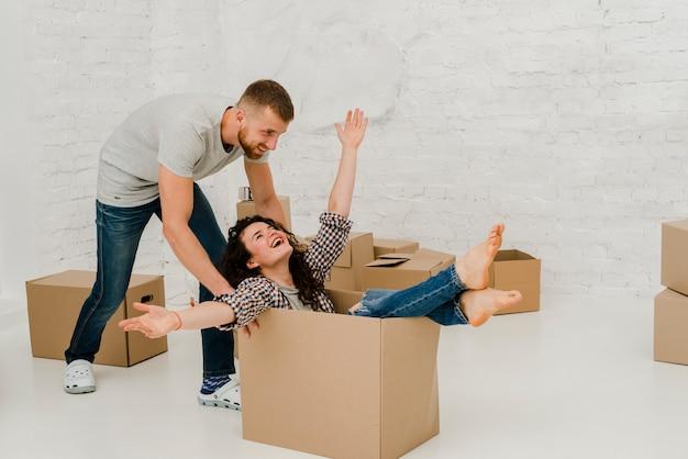 Man dragging woman in box Premium Photo
