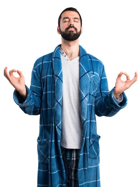 Man in dressing gown in zen position Free Photo
