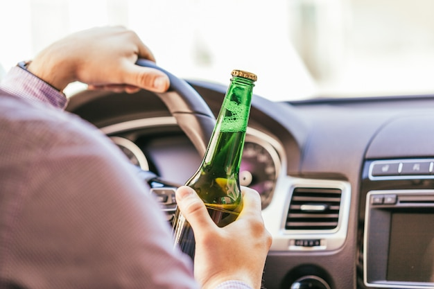 Man drinking alcohol while driving the car Premium Photo