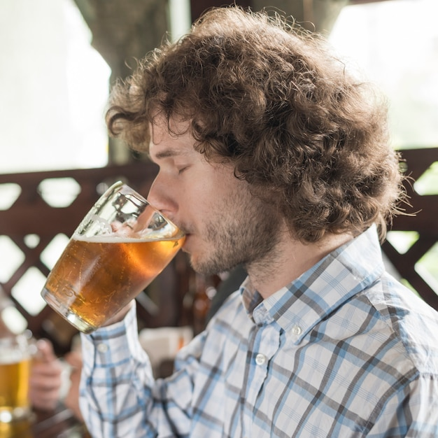 Man drinking beer with closed eyes Free Photo