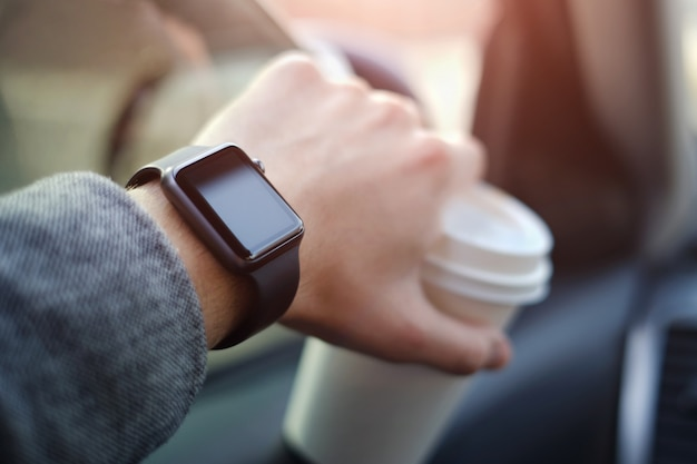 Man driving a car with watch on his hand Premium Photo
