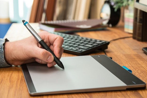 Man during using a graphic tablet Premium Photo