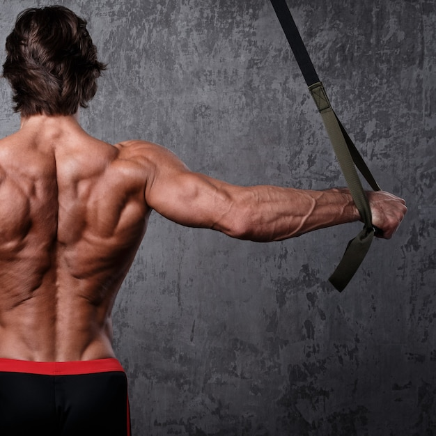 Man during workout with suspension straps Premium Photo