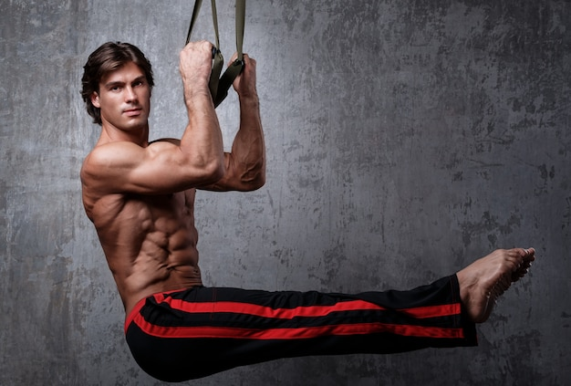 Man during workout with suspension straps Premium Photo