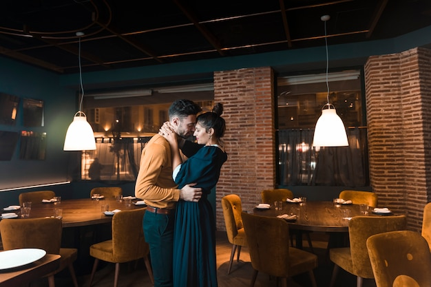 Man embracing with woman in restaurant Free Photo