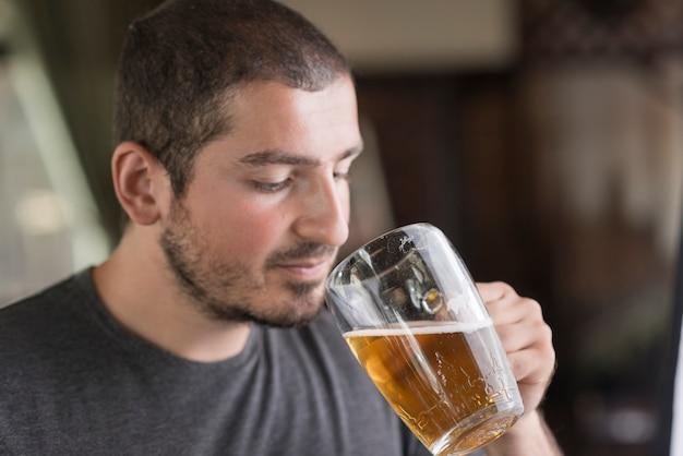 Man enjoying beer in bar Free Photo