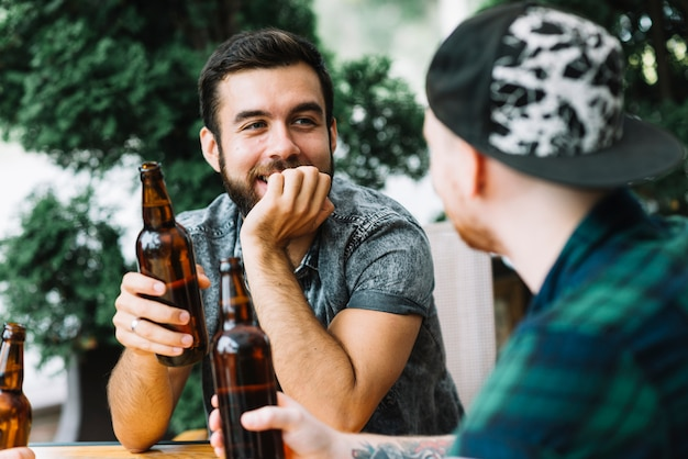 Man enjoying beer with his friends Free Photo