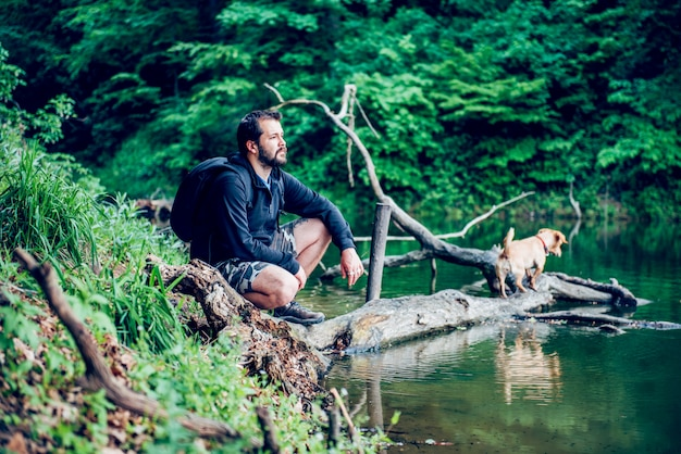 Man enjoying nature with the dog Premium Photo