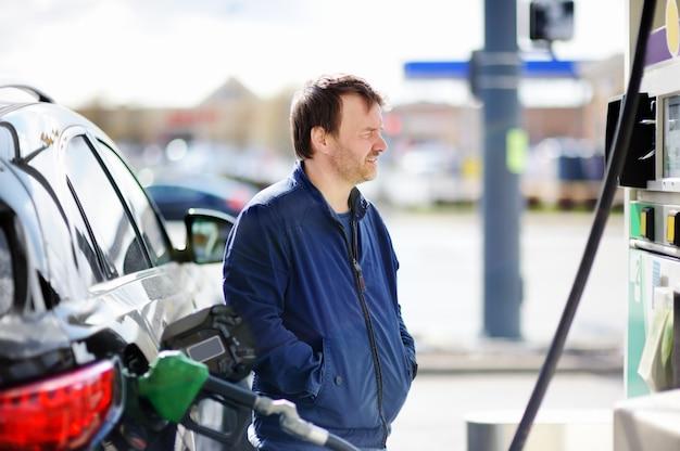 Man filling gasoline fuel in car Premium Photo