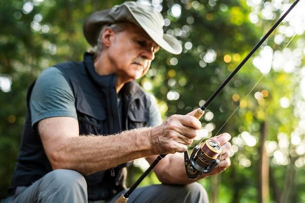 Man fishing by a lake Premium Photo