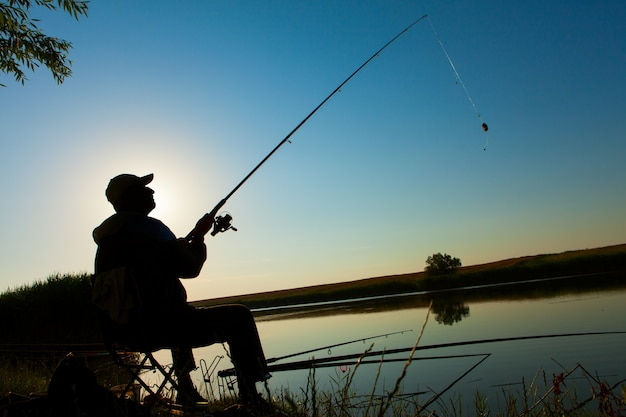 Man fishing on a lake Free Photo