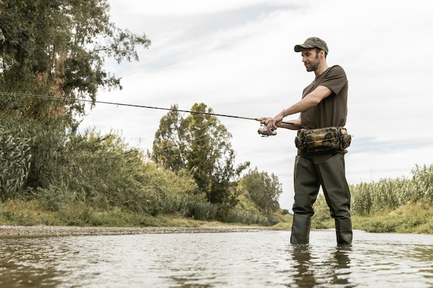 Man fishing at the river Free Photo