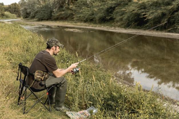 Free Photo | Man fishing at the river