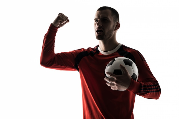 Man football soccer player silhouette in studio isolated on white stands with a ball victory Free Photo