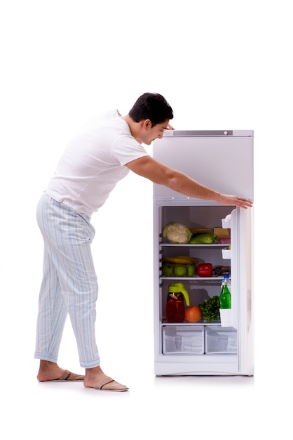 Man next to fridge full of food Premium Photo