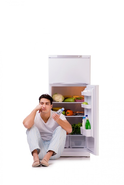 Man next to fridge full of food Premium Photo