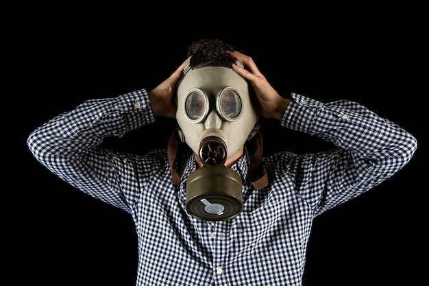 A man in a gas mask is worried about the current situation Premium Photo