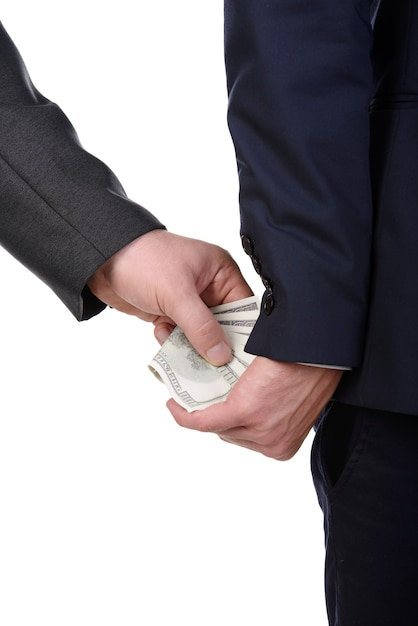 Man gently takes a bribe isolated Premium Photo